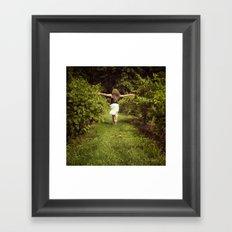 Young woman running through a vineyard Framed Art Print