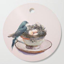 Bird nest in a teacup Cutting Board