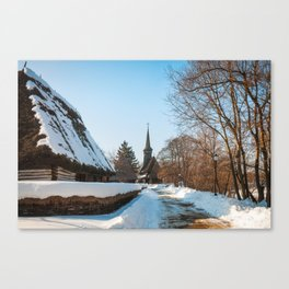 Heavy snow on a street in a traditional Romanian village Canvas Print