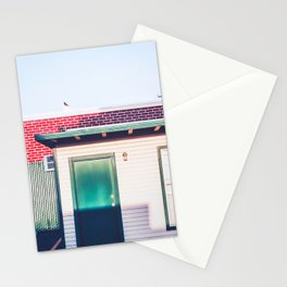 green wood building with brick building in the city Stationery Cards