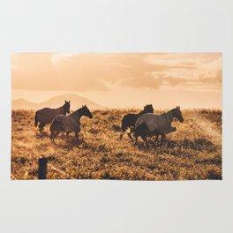 wild horses at dusk Rug