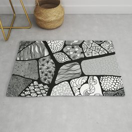 patchwork with black and white patterns Rug