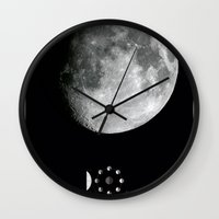 moon phase Wall Clocks featuring Moon by Alejandro de Antonio Fernández