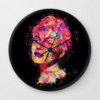 wasted rita Wall Clocks featuring Rita by Alessandro Pautasso