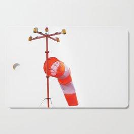 Orange-white windsock on white isolate background Cutting Board
