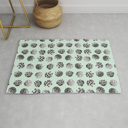 Beach Seashell pattern in black and turquoise Rug