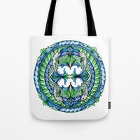 dolphins Tote Bags featuring Dolphins by Humna Mustafa