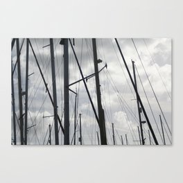 Yacht masts on cloudy sky Canvas Print