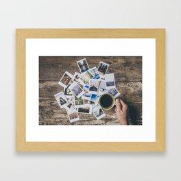 Polaroids prints on a wooden table Framed Art Print