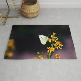 White Butterfly on Yellow Flowers Rug