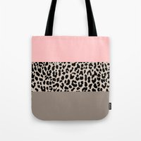 the national Tote Bags featuring Leopard National Flag XVI by Mango Tangerine Studio