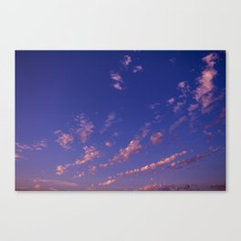 Small clouds in the blue sky during sunset. Canvas Print
