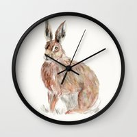 hare Wall Clocks featuring HARE  by Joelle Poulos