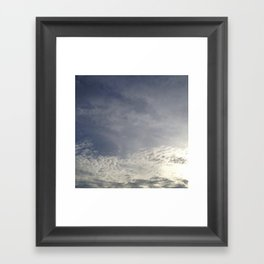 with clouds the sun sets Framed Art Print
