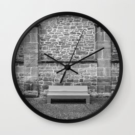 Detail of bench to sit and rest in the city Wall Clock