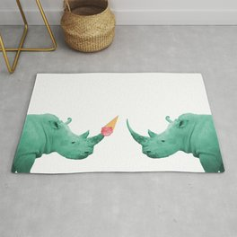 two turquoise rhinos with ice cream cone Rug