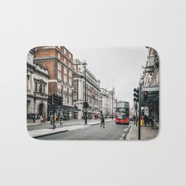 Red bus in Piccadilly street in London Bath Mat
