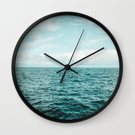 Flat horizon of the sea with calm, smooth turquoise blue waves Wall Clock