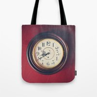 wall clock Tote Bags featuring Old wall clock by Elisabeth Coelfen