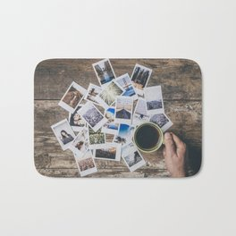 Polaroids prints on a wooden table Bath Mat