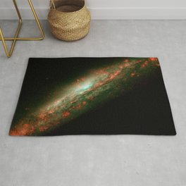 A lumpy bubble of hot gas rises from a cauldron of glowing matter in a distant galaxy as seen by NAS Rug