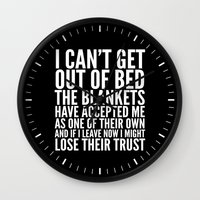 blankets Wall Clocks featuring THE BLANKETS HAVE ACCEPTED ME AS ONE OF THEIR OWN by CreativeAngel