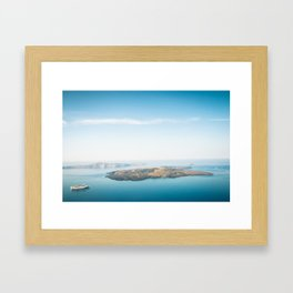 Beautiful landscape with sea view. Cruise liner at the sea near the Nea Kameni, a small Greek island Framed Art Print