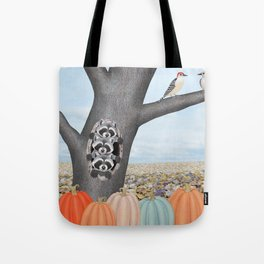 red bellied woodpeckers, heirloom pumpkins, and raccoons in a tree Tote Bag