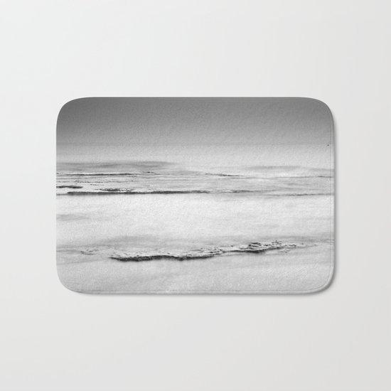 """""""Foggy beach"""". Calm sea at sunset Bath Mat"""