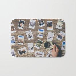 Photo prints on the table Bath Mat