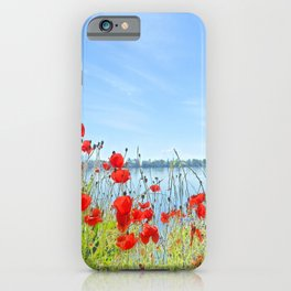 Red poppies in the lakeshore iPhone Case