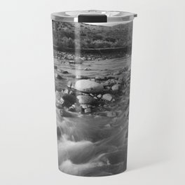 Man with rifle stands in mountain stream as it floods, east of Palmdale, California, ca.1920 Travel Mug