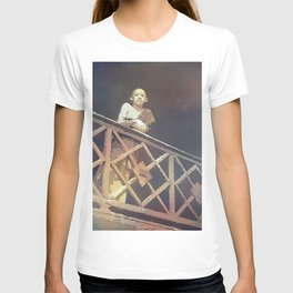 Buddhist monk standing by railing of Wat in the city of Phnom Penh- Cambodia. T-shirt