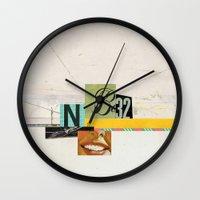 bon iver Wall Clocks featuring super bon bon by Robert Alan