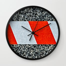 Red warning tape across granite stone Wall Clock