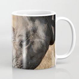 Rhinoceros Eating Grass In A Field Coffee Mug