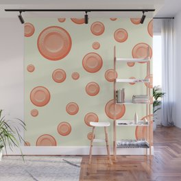 Orange clay targets on a cream background Wall Mural