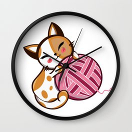 Cute cat playing with yarn Wall Clock