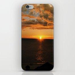 Sun on the skyline iPhone Skin