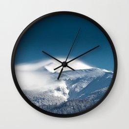 Misty clouds over snowy mountain Snežnik, Slovenia Wall Clock