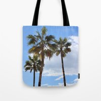 palm trees Tote Bags featuring Palm Trees by Rebecca Bear
