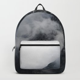 White clouds over the dark rocky mountains Backpack