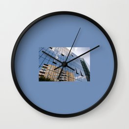Modern skyscraper with glass wall of windows Wall Clock