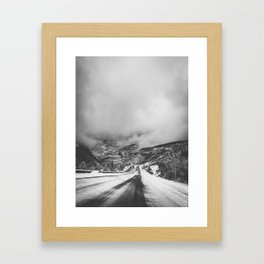 road leading down into a storm Framed Art Print