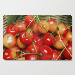 Cherries in a Basket Close Up Cutting Board