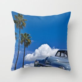 Vintage Blue Plymouth Automobile against Palm Trees and Cloudy Blue Sky Throw Pillow