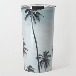 Two towels on the white sand of a beach in Parque Tayrona, Colombia, under tall palm trees Travel Mug