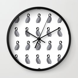 Baby penguins in a row with mum and dad. Wall Clock