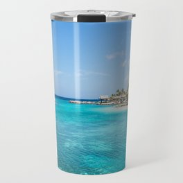 Blue water lake with huts and palm trees around Travel Mug
