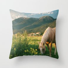 Pretty Horse Eating Grass in the Montana Sunset Throw Pillow